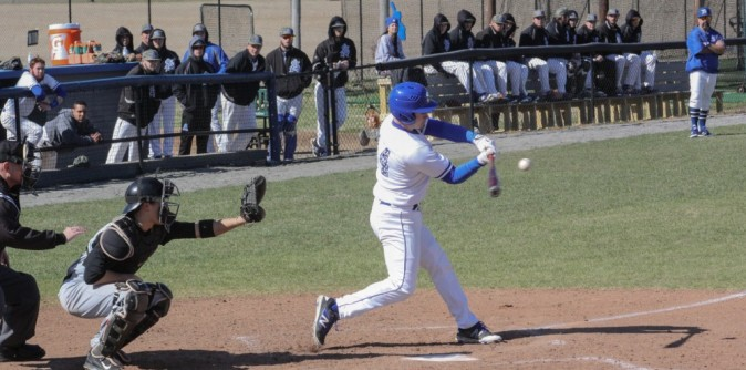 Ayer's complete game shutout leads Knights to split with Truett