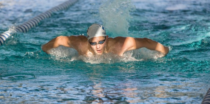 Swim teams win relays on first day of AACs